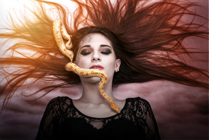Woman lying on the floor with eyes closed, face the snake slither-awesome